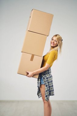 woman with many boxes