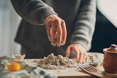 Close up of woman`s hands making a bread.