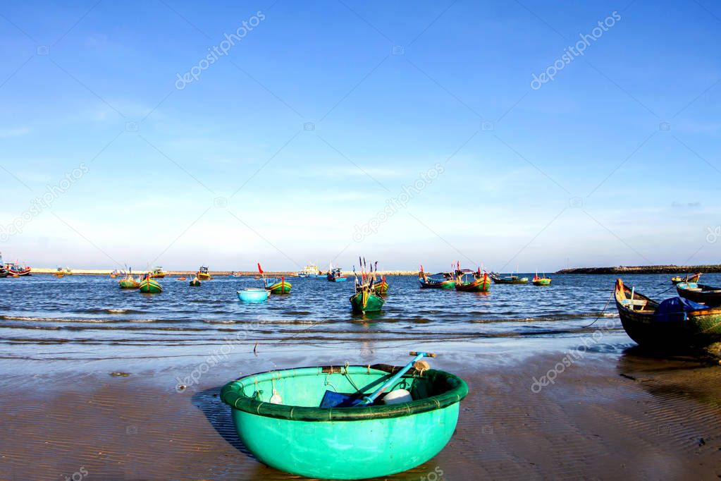 Vietnam fishing tools and beautiful white beach with blue sky in