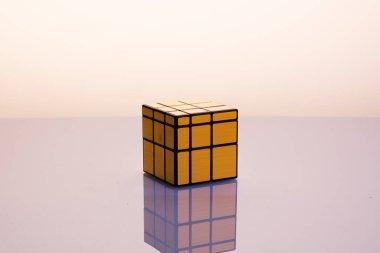 Gold Rubik's Cube on mirrorless background