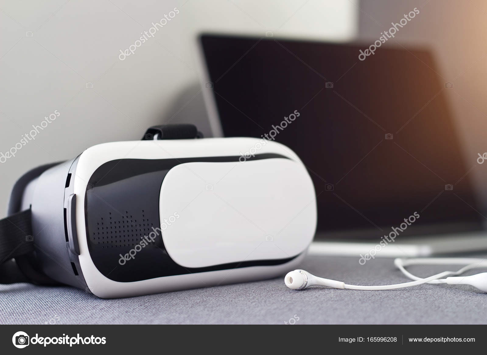 b97ff73b9212 VR headset with earphone and laptop on sofa — Stock Photo © ipopba ...