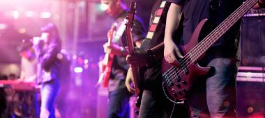 Guitarists on stage for background, soft focus and blur concept
