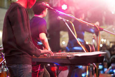 Keyboardist on stage for background, soft and blur concept