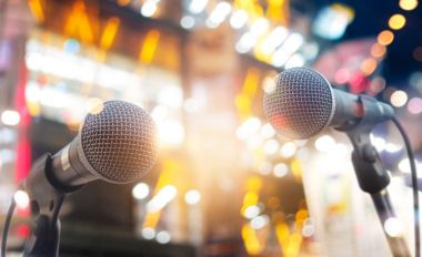 Microphones on concert stage lighting background