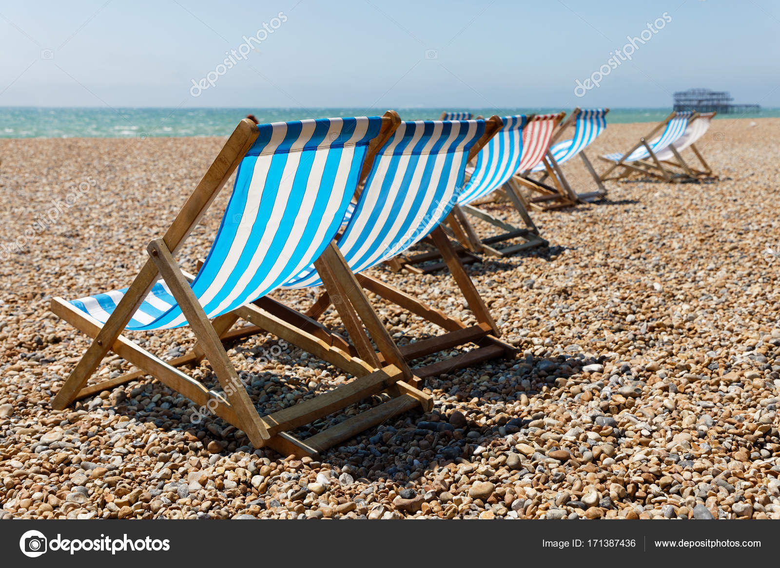 Classic Blue, Red And White Striped Empty Deckchairs On The Beac U2014 Stock  Photo