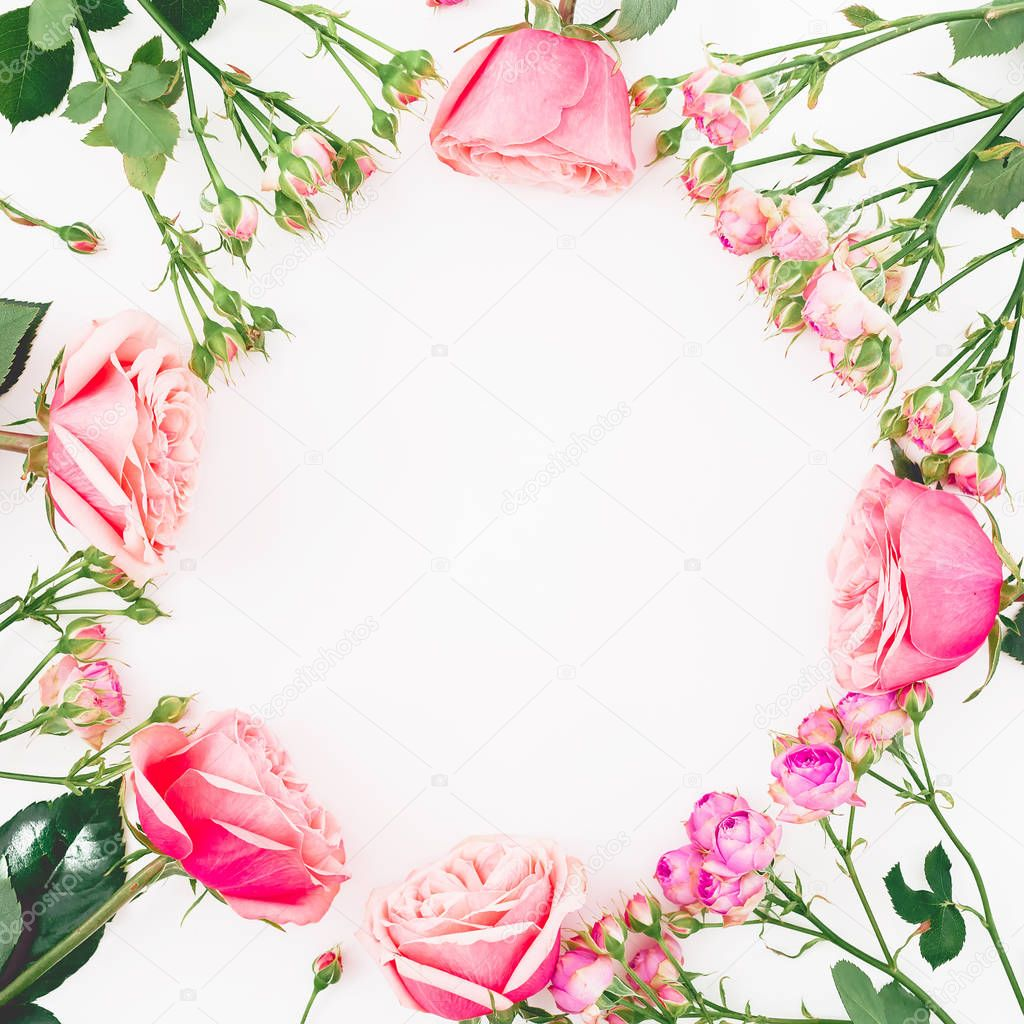 Floral round frame with roses and leaves on white background. Flat lay, top view. Frame background