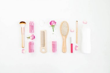 Hair styling concept with tools on white background. Beauty composition. Flat lay, top view