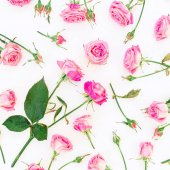 Photo Floral pattern with pink roses on white background. Flat lay, Top view.