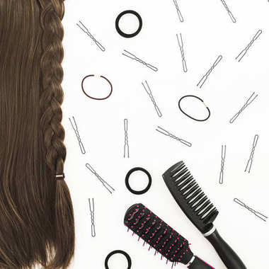 Frame with combs for hair styling, barrettes on white background. Beauty blog composition. Flat lay, top view