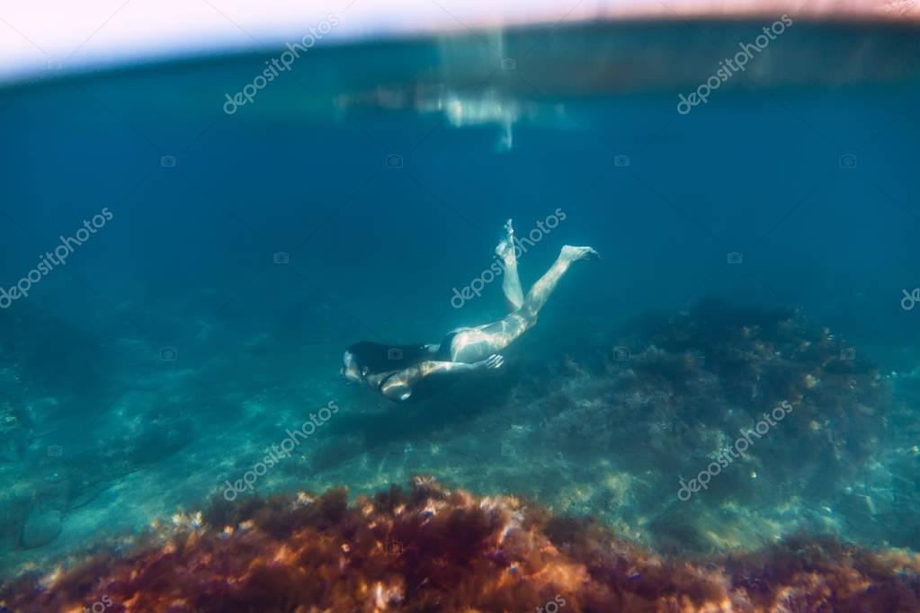 Beautiful young woman underwater.