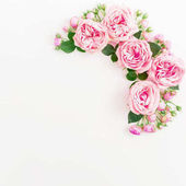 Floral pattern with pink roses on light background. Flat lay, Top view.