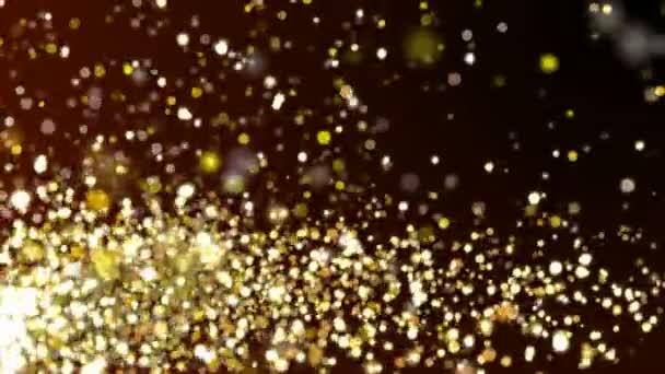 Zlaté třpytky jiskří textury na tmavém pozadí. Lesklé abstraktní animace.