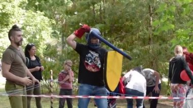 Amator training knights fights. Training in the central park in the summer.