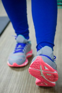 Colorful sporty shoes making steps to a healthy lifestyle.