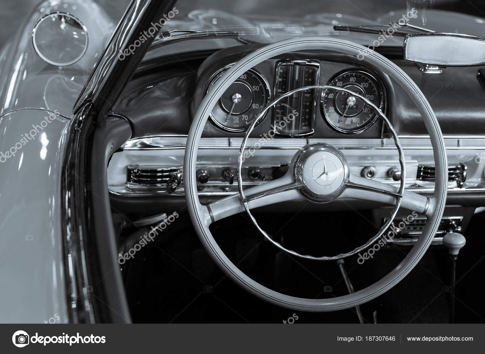 Wooden Steering Wheel And Leather Dashboard Of A Vintage Car Stock