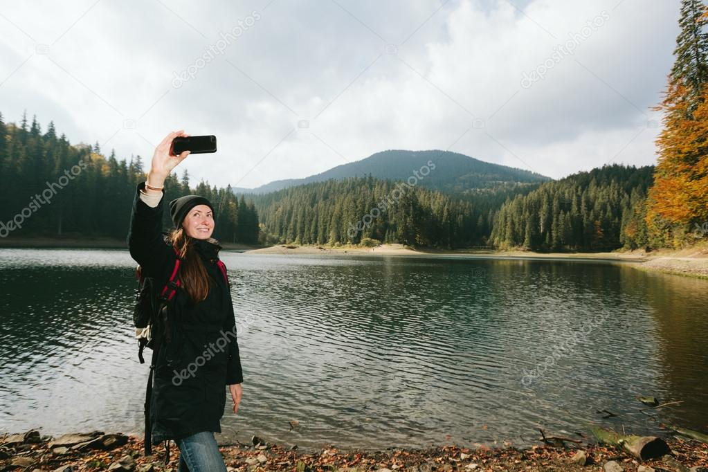 woman taking a selfy while hiking in the nature