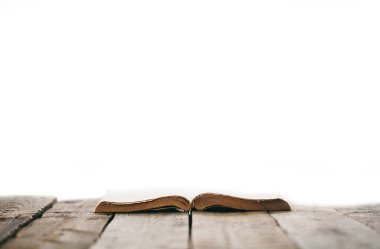 Old bible on a wooden table