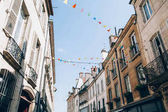Fotografie Vintage city buildings with flags in Europe