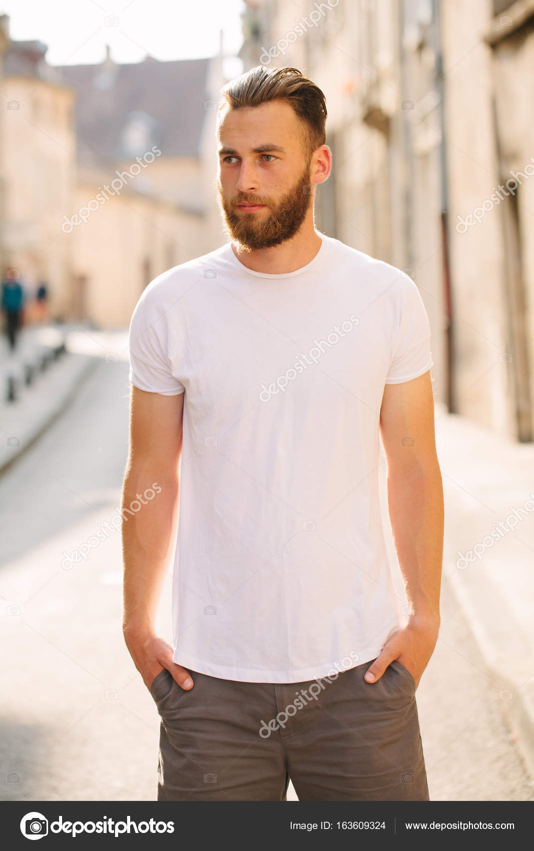 375f294cd0a5 Hipster handsome male model with beard wearing white blank t-shirt with  space for your logo or design in casual urban style — Photo by 4masik