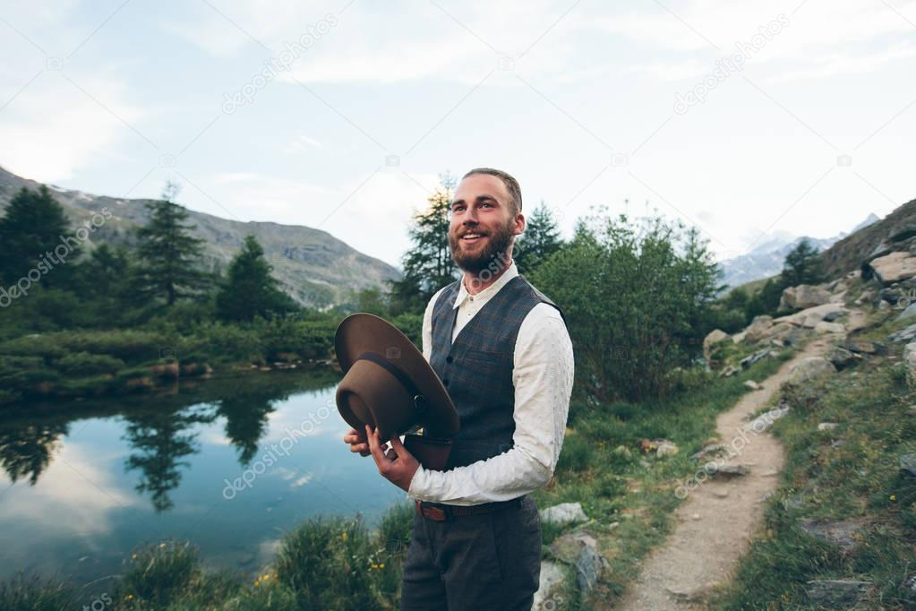 Hipster handsome male model portrait with beard wearing trendy c