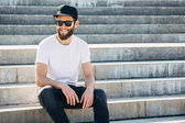 Hipster handsome male model with beard  wearing white blank  t-s