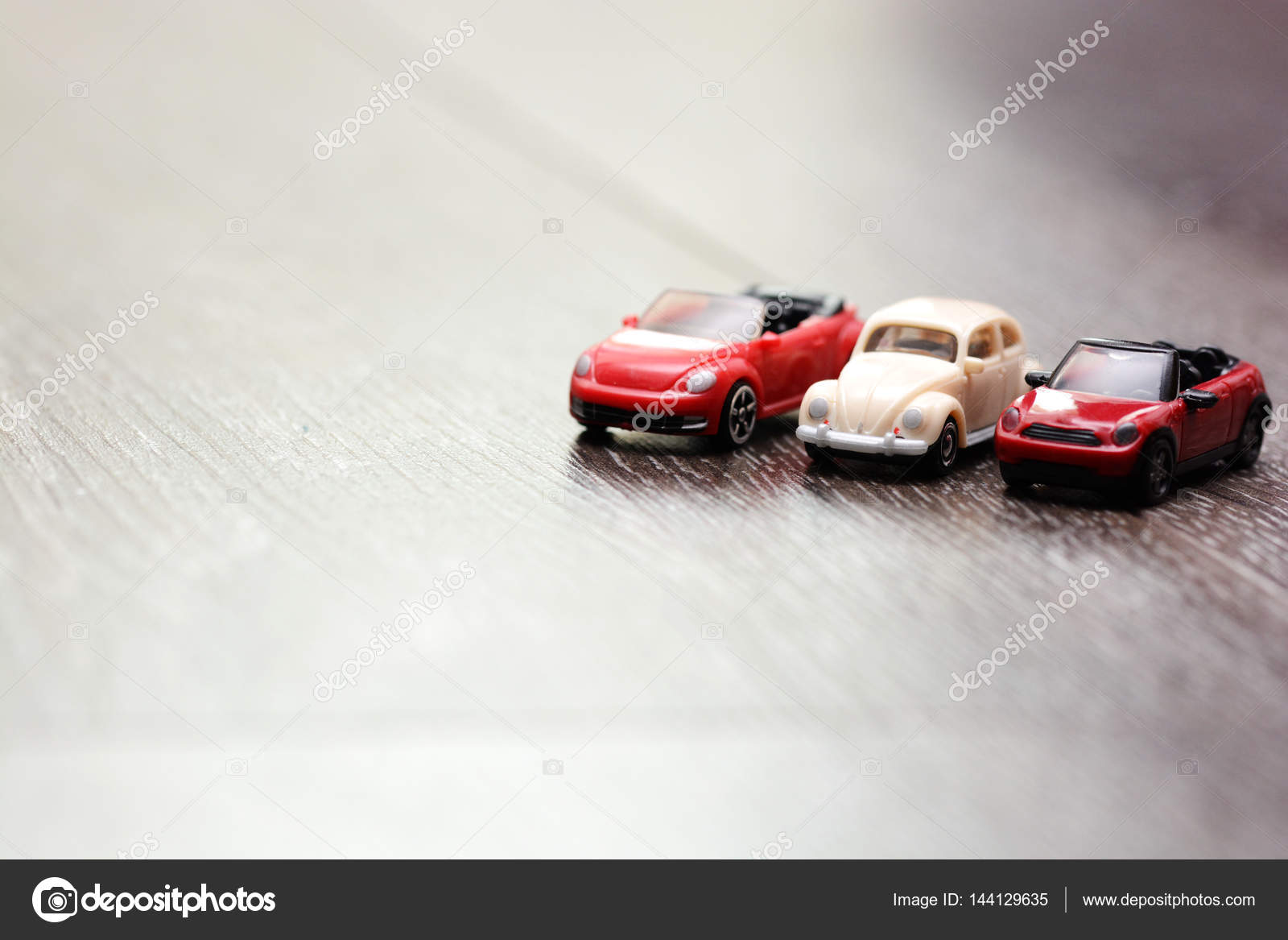Vintage car models aligned on a wooden background — Stock Photo ...