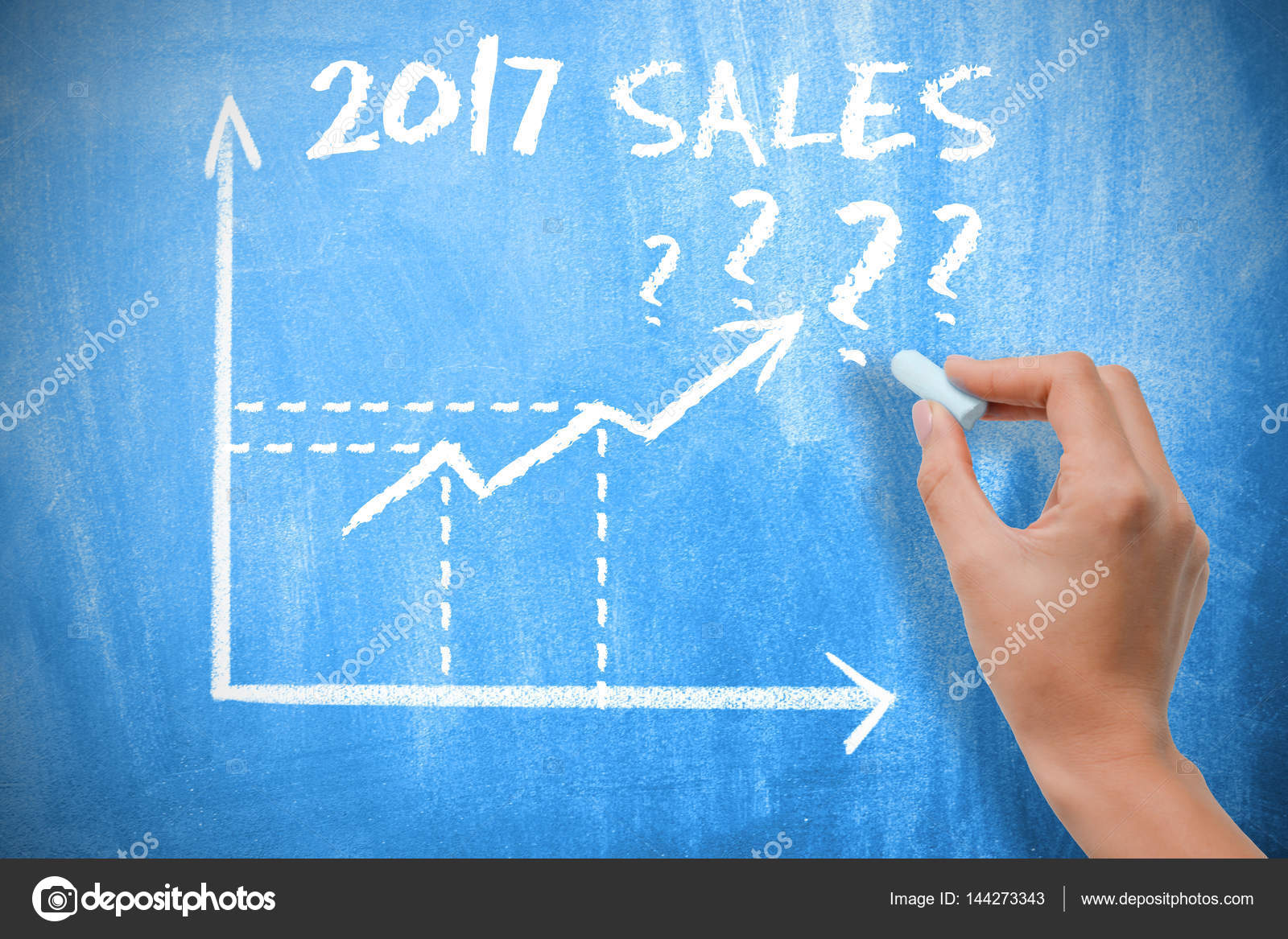 sales forecast for 2017 with graph chart on blue chalkboard stock