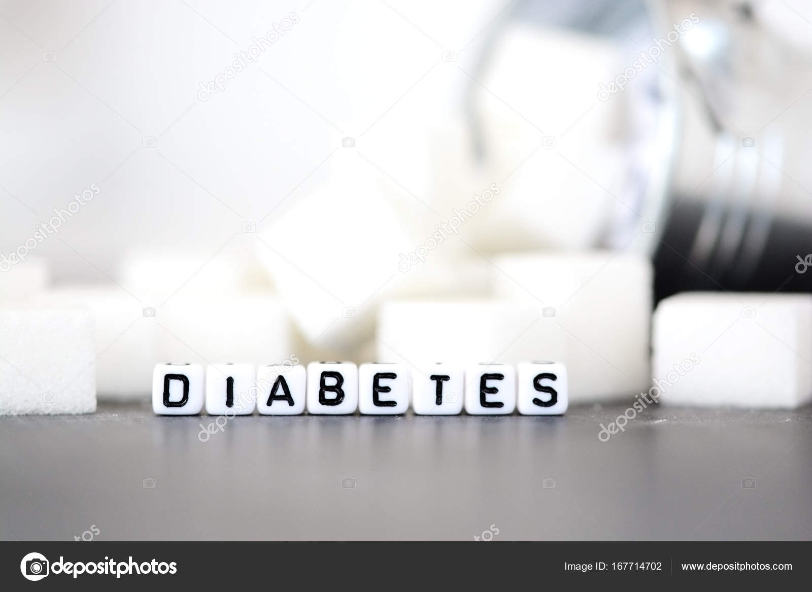 Diabetes Illness Concept With White Letter Beads In Front Of Pile Of