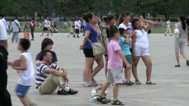 Relax in the weekend of people on street city of Tiananmen Square.
