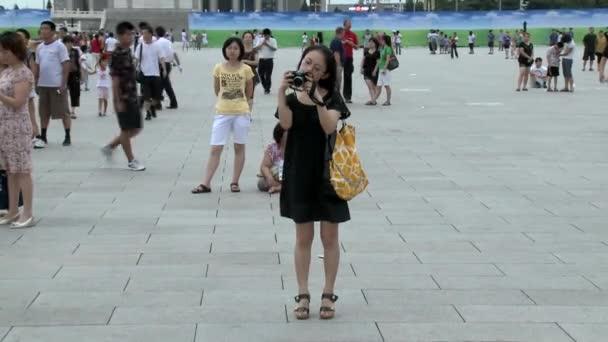Girl walk on street city of Tiananmen Square.