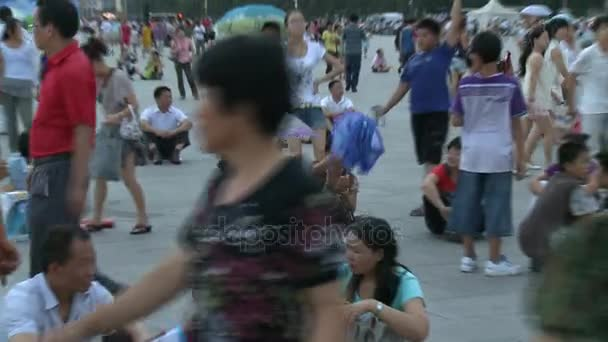 People are sitting in rain on street city of Tiananmen Square.