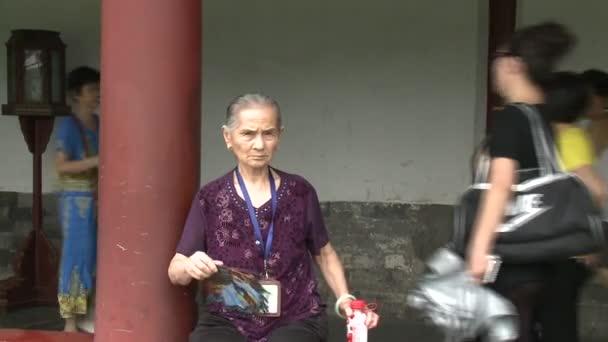 Old woman on street.