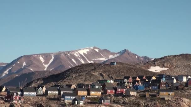 Small city in the mountains and on the shores of Greenland Arctic Ocean