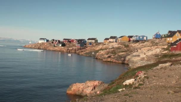 Village in the mountains on the shore of the Arctic Ocean from Greenland.