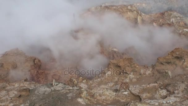 Hot surface of geysers in mountain on shores of Arctic Ocean in Greenland.