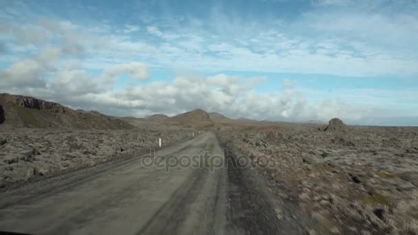 Road to the background of mountains and clouds in the sky in Greenland.