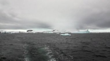 Ice movement and snow iceberg and glacier view from ship in ocean of Antarctica.