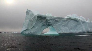 Arch of Darwin only unique glacier iceberg in ocean of Antarctica.