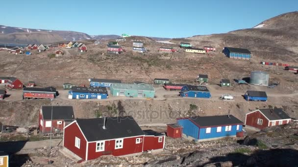Houses in the city on the shores of Arctic Ocean in Greenland. General plan.
