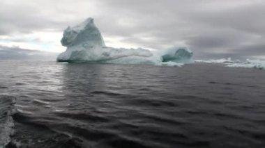 Ice movement icebergs of global warming floats in ocean of Antarctica.