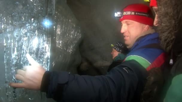People tourist cave in Svalbard Arctic.