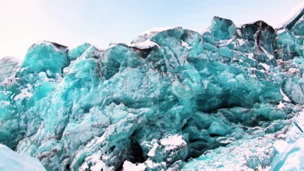 Glacier of beautiful unique turquoise color on background of snow in Arctic.