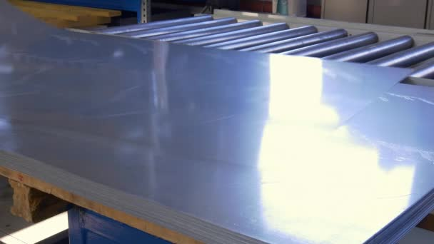 Cutting sheet metal on industrial CNC machine in factory.