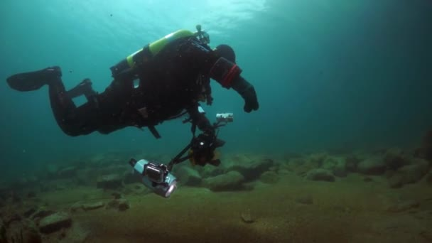 Cameramen scuba diver under water in Lake Baikal.