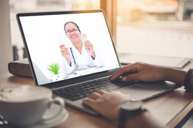 The patient's viewpoint consult with the doctor via social media such as laptop, smartphone, almost. The work for home concept of doctors and patients.