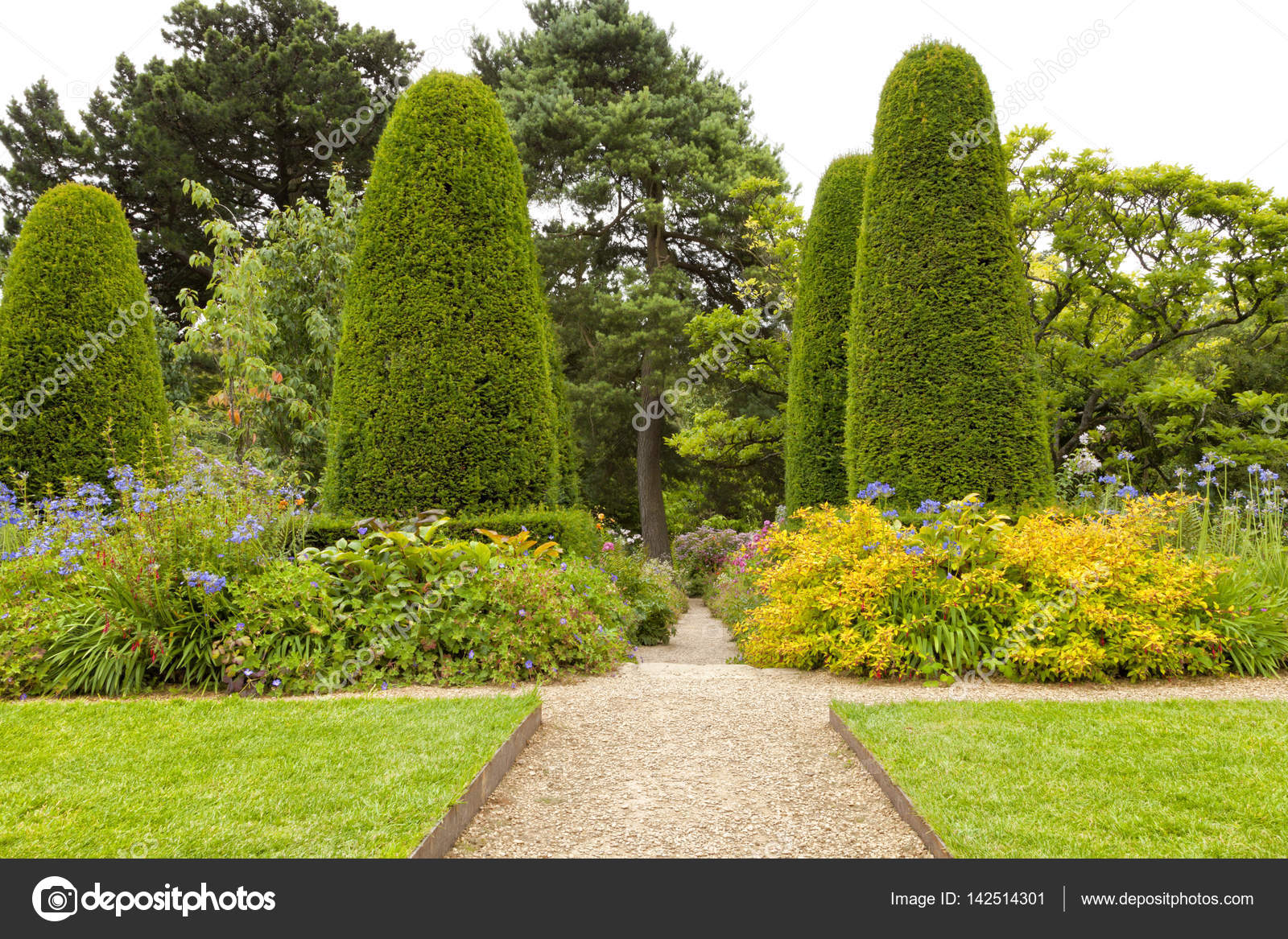 Walking Path Through A Landscaped Summer Garden With Flowers, Trees,  Conifers U2014 Stock Photo