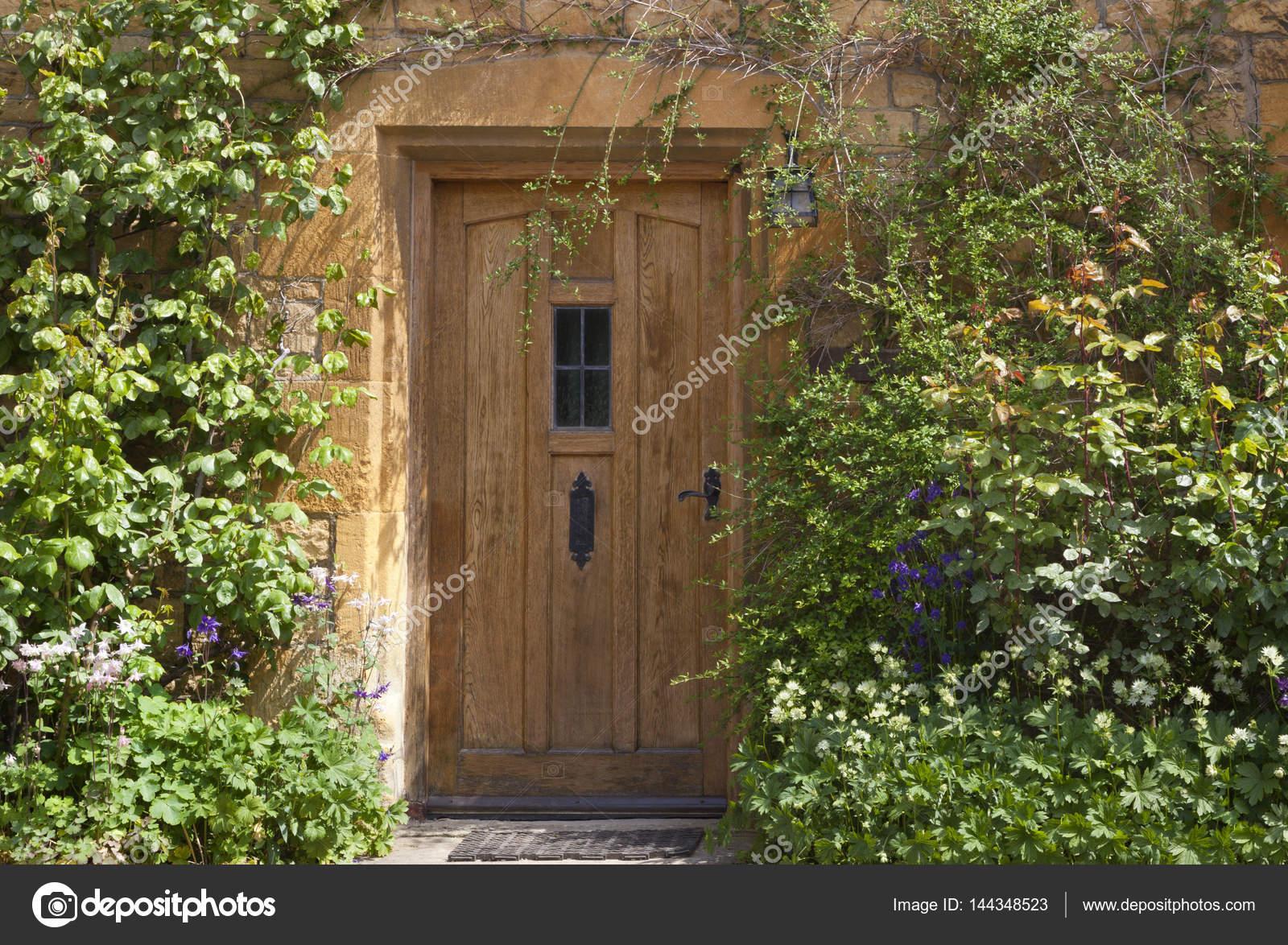 Light brown house doors to english cottage — Stock Photo © Yolfran ...
