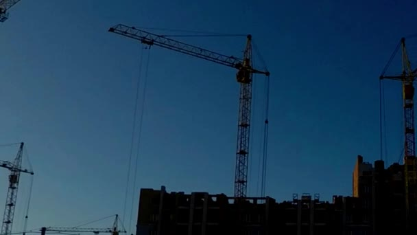 panoramic photography, the construction of a residential building tower cranes, Pulley construction company. timelapse