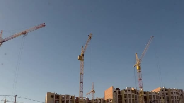 the construction of a residential district in the Siberian city of cranes on a background of blue sky. taymlaps