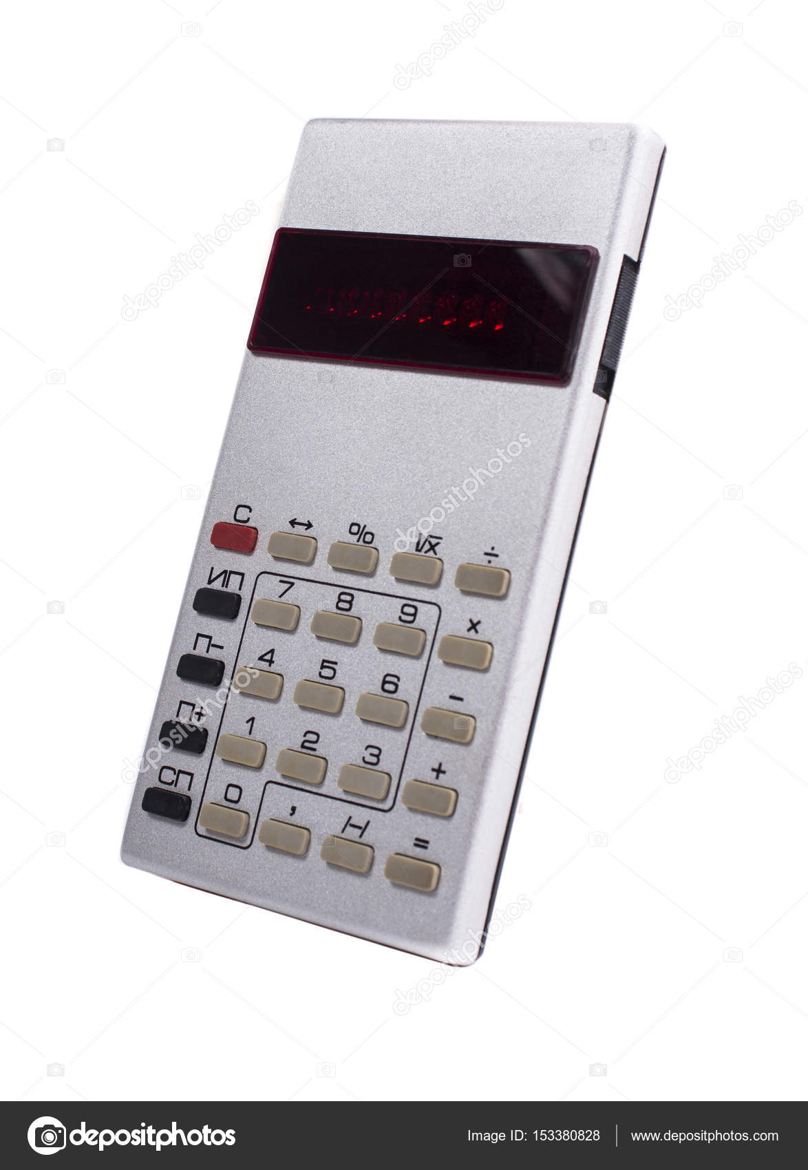 Old silver calculator made by USSR on white background